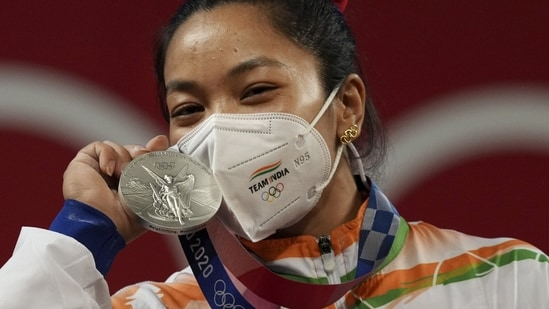 India's Mirabai Chanu poses with her silver medal at the Summer Olympics 2020(PTI)