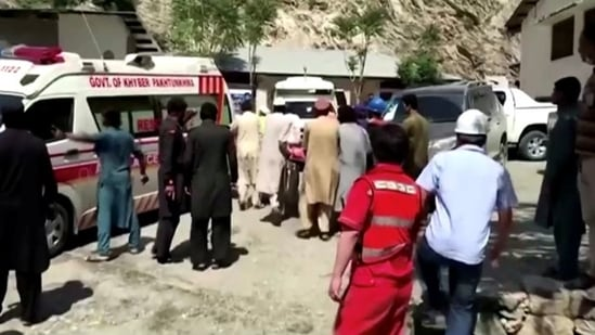 People wheel a gurney towards an ambulance outside a hospital in Dasu, after a bus with Chinese nationals on board plunged into a ravine in Upper Kohistan following a blast, Pakistan. (REUTERS)