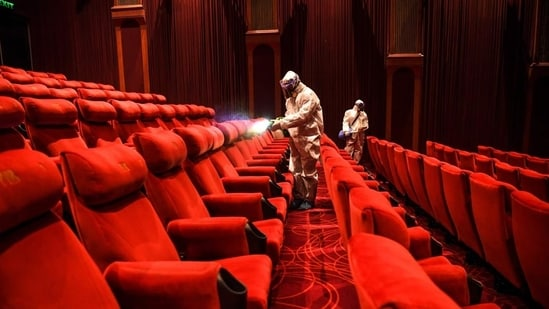 Cinema halls, multiplexes and auditoriums will be allowed to run with 50% seating capacity, according to the DDMA order issued on Saturday.(AFP)