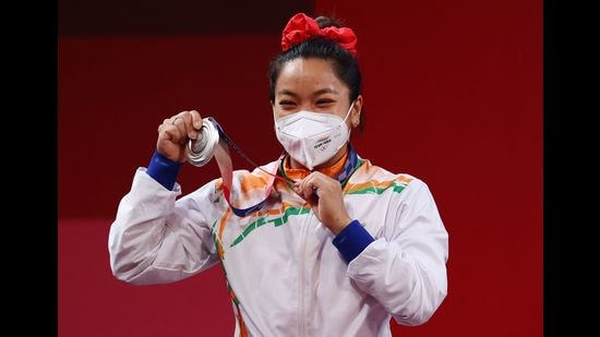 Manipur girl Saikhom Mirabai Chanu has won India's first medal at the 2020 Tokyo Olympics in 49 kg category in women's weightlifting event. (Photo: Edgard Garrido/Reuters)
