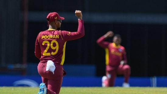 Nicholas Pooran of West Indies kneels for Black Lives Matter during the 2nd ODI between West Indies and Australia at Kensington Oval.(AFP)