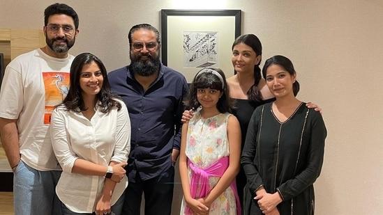 Aishwarya Rai, Abhishek Bachchan, and Aaradhya Bachchan pose with Sarath Kumar and his family.