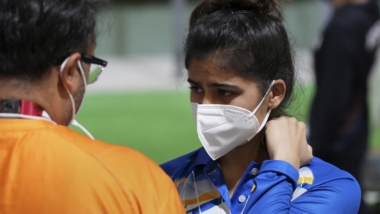 India's Manu Bhaker with Coach Ronak Pandit (L) reacts after the 10m Air Pistol Women's Qualification at the Summer Olympics 2020.(PTI)