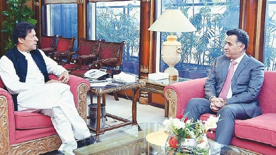 Pakistan Prime Minister Imran Khan is seen with ISI chief Faiz Hameed in this file photo. (Dawn Photo)