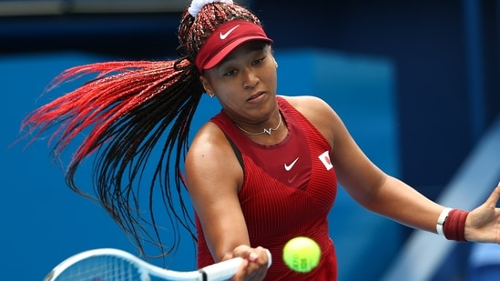 Naomi Osaka of Japan in action during her second round match against Viktorija Golubic of Switzerland at the Tokyo Olympics.(REUTERS)
