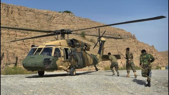Afghan National Army soldiers unload food items and petrol oil from an Afghan Air Force Black Hawk helicopter at the hydroelectric Kajaki Dam in Kajaki, northeast of Helmand Province. (Representational image/AFP)