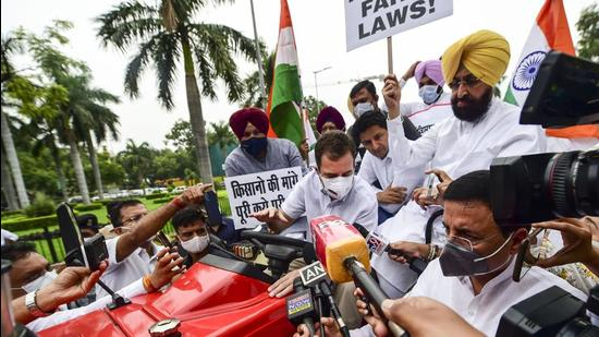 Congress leader Rahul Gandhi on a tractor outside the Parliament, in support of farmers' agitation against Centre's farm laws, in New Delhi on Monday, July 26. (PTI)