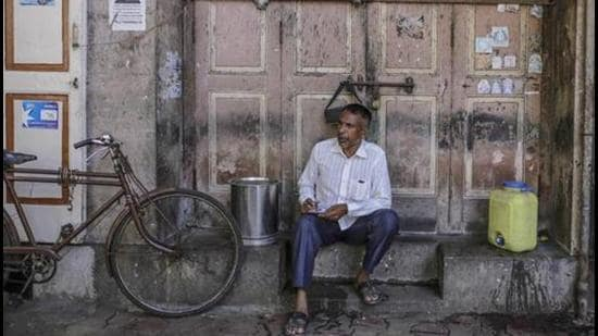 A man sits outside a closed store in Mumbai. (Representational image/Bloomberg)