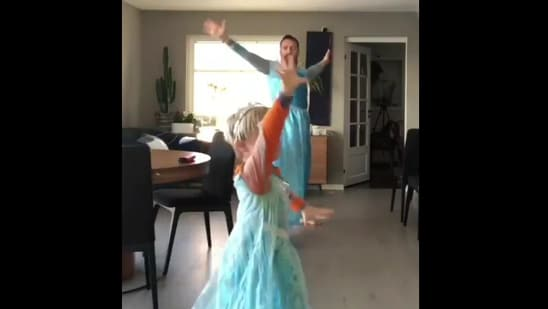 The image shows the dad dancing with his son to a Frozen song.(Reddit)