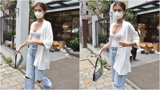 Tara wore a white fitted bodysuit with high-waist flared and distressed denims. Her sleeveless top featured a plunging V neckline, and the light-blue pants had frayed hems.(Varinder Chawla)