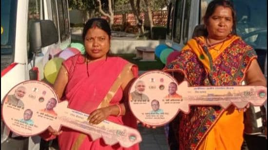 Two members of women SHGs with dummy keys to the four-wheelers they bought on Aajeevika mission loan. (Sourced)