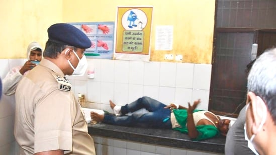 ADG (Lucknow Zone) SN Sabat visits the injured victims at a hospital after a speedy truck hit a stationary passenger bus in Barabanki, late on Tuesday.(PTI Photo)