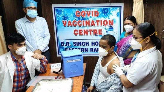 A beneficiary gets a shot of Covid-19 vaccine in a mobile vaccination train in Kolkata on Monday. (ANI)