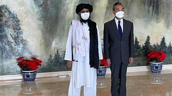 Taliban leader Mullah Baradar Akhund with Chinese foreign minister Wang Yi.
