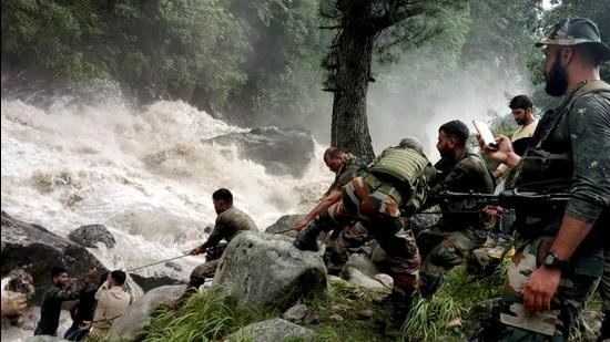 Army personnel during a rescue operation after flash floods due to a cloudburst at Honjar in Kishtwar district. (PTI)