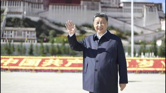 Chinese President Xi Jinping waves while visiting a public square below the Potala Palace in Lhasa in western China's Tibet Autonomous Region on July 22. (AP)