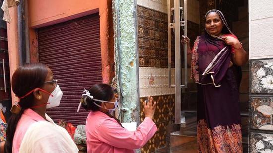 ASHA workers on a door-to-door screening survey for Covid. (HT file)