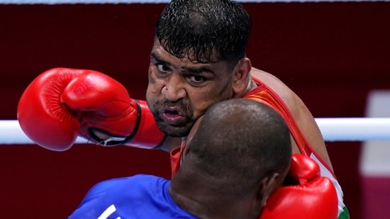 Satish Kumar, top, of India exchanges punches with Ricardo Brown of Jamaica during their men's super-heavy weight 91 kg preliminaries round Boxing match at the 2020 Summer Olympics, Thursday, July 29, 2021, in Tokyo, Japan. (AP)