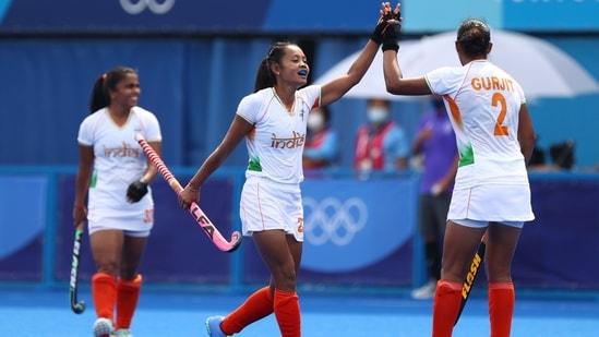 Tokyo 2020 Olympics - Hockey - Women's Pool A - Ireland v India - Oi Hockey Stadium, Tokyo, Japan - July 30, 2021. Sushila Chanu Pukhrambam of India and Gurjit Kaur of India celebrate their goal.(REUTERS)