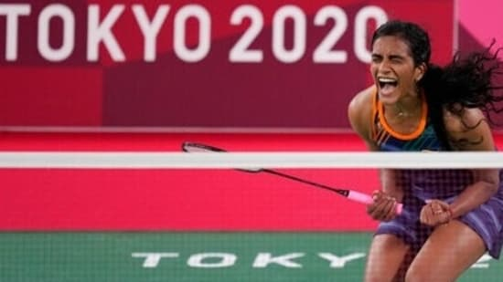 India's PV Sindhu celebrates after wining against Japan's Akane Yamaguchi during their women's singles badminton quarterfinal match at the 2020 Summer Olympics, Friday, July 30, 2021, in Tokyo, Japan. (AP)