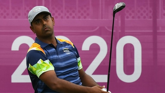 Olympics: Anirban Lahiri (in frame) slips on weather-hit second day, lies 20th as stars move into top gear.(AFP)