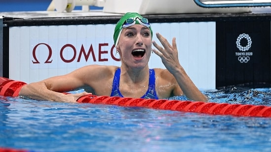 South Africa's Tatjana Schoenmaker celcbrates after she set a new World Record to take gold in the final of the women's 200m breaststroke swimming event during the Tokyo 2020 Olympic Games at the Tokyo Aquatics Centre in Tokyo on July 30, 2021.(AFP)