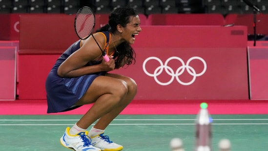 Pusarla V. Sindhu celebrates after winning against Japan's Akane Yamaguchi during their women's singles badminton quarterfinal match at the 2020 Summer Olympics,.(AP)