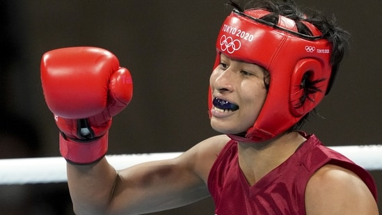 India's Lovlina Borgohain clenches her fist after winning her bout against Chen Nien-Chin of Chinese Taipei during women's welterweight (64-69kg) category boxing match, at the Summer Olympics 2020 in Tokyo. (PTI)