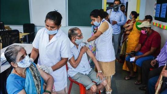 Health workers administer Covid-19 vaccine dose to senior citizens at a school-turned-vaccination centre in Thane on July 7. (PTI)