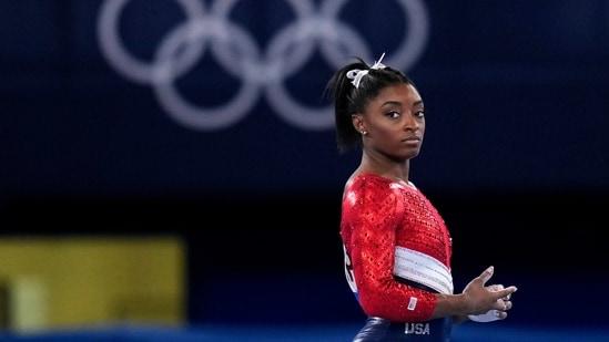 "Olympics: USA's Simone Biles says she's dealing with ""twisties"".(AP)"