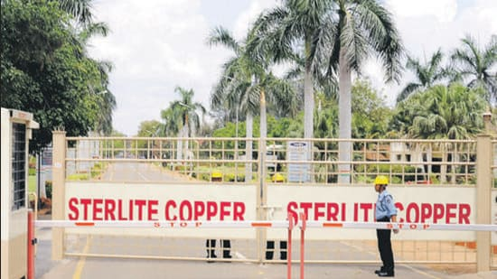 A private security guard stands in front of the main gate of Sterlite Industries Ltd's copper plant in Tuticorin in 2013. (Reuters)