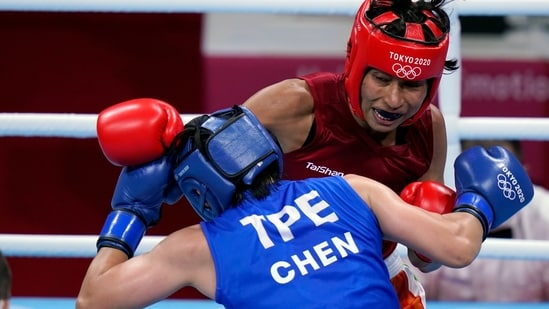 Lovlina Borgohain delivers a punch to Nien-Chin Chen at the Tokyo Olympics 2020(AP)