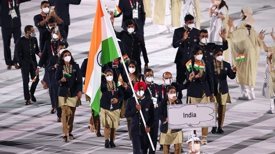 The Tokyo 2020 Olympics opening ceremony: Country No.21, India, were led out by Manpreet Singh and MC Mary Kom.(TWITTER)