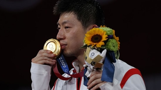 Ma Long of Team China poses with his medal. (Getty Images)