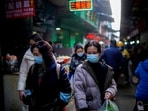 People wearing face masks walk on a street market, following an outbreak of the coronavirus disease in Wuhan, China.(Reuters File Photo)