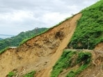 Commuters had a narrow escape when a stretch of national highway (NH) 707 was swept away in a landslide near Barwas in Kamrau tehsil of Sirmaur district on Friday. (HT Photo)