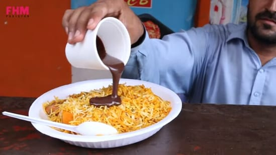 The image shows the biryani and chocolate dish being prepared.(YouTube/@FHM Pakistan)