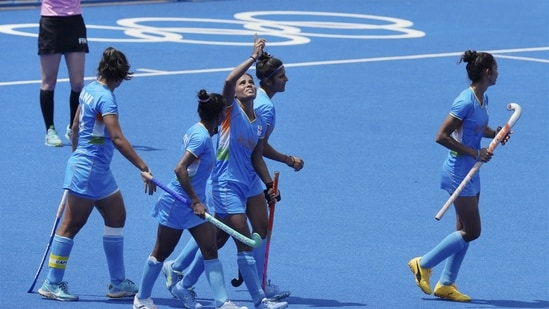 Vandana Katariya celebrates with teammates after scoring a goal against South Africa during a women's field hockey match at the 2020 Summer Olympics.(PTI)