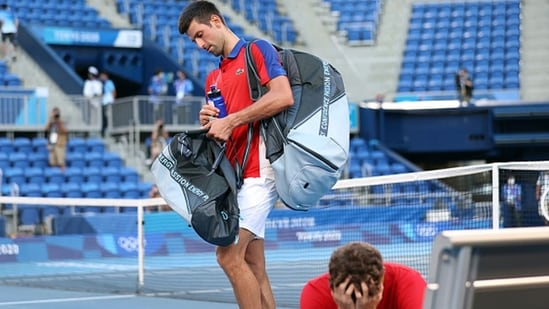 Novak Djokovic of Serbia exits the court after being defeated by Pablo Carreno Busta. (Getty Images)