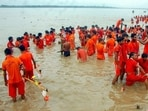 In this 2018 file photo, Kanwariyas take a dip in the river Ganga on the first day of the holy month of Shravan, at Vindhyachal Dham in Mirzapur. (PTI)