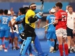 Sreejesh Parattu Raveendran of Team India and Thomas Sorsby of Team Great Britain fist bump. (Getty Images)