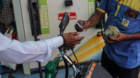 A motorcyclist pays while refueling at a Bharat Petroleum Corp. gas station in Jalgaon, Maharashtra, India, on Monday, July 19, 2021. (Bloomberg)