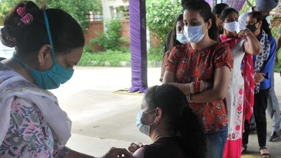 A health worker administers Covid vaccine to a resident in Mohali. (Ravi Kumar/HT)