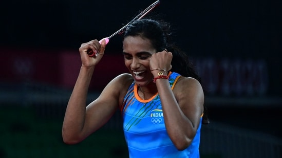 India's P. V. Sindhu celebrates after beating China's He Bingjiao in their women's singles badminton bronze medal match during the Tokyo 2020 Olympic Games at the Musashino Forest Sports Plaza in Tokyo on August 1, 2021.(AFP)