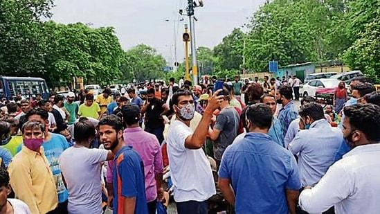 Protesters outside the crematorium in southwest Delhi. sourced