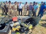 Police personnel inspect the site after a helicopter of the army crashed into the Ranjit Sagar Dam lake in Kathua on Tuesday. PTI(PTI)