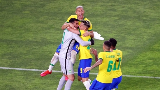 Tokyo Olympics: Reinier of Brazil celebrates scoring the winning penalty during a penalty shootout with teammates(REUTERS)