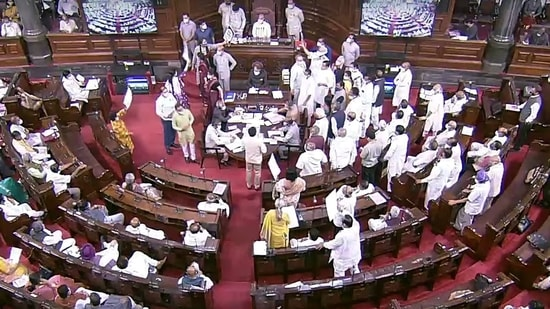 Opposition leaders stage a protest in the well of the Rajya Sabha during the Monsoon session of Parliament, in New Delhi.