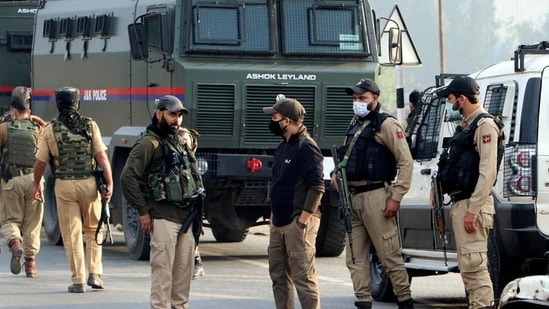 Jammu and Kashmir Police stand guard at an encounter site, in Kulgam.(ANI File Photo)