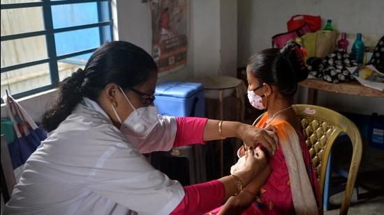 A healthcare worker inoculates a woman with a dose of vaccine against Covid-19 at a primary health centre in Siliguri on August 2. DUTTA / AFP) (AFP)